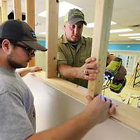 Mike and Mike Eleopoulos Jr., of Mike's Roofing and Construction, install framing on the walls at the Autsim Center of North Mississippi's new space. The Autism Center has received a grant to fund to renovations to allow them to start a new program aimed at daily living, pre-vocational and social skills for people with autism.
