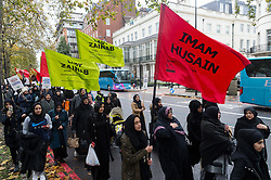 CAPTION CORRECTION © Licensed to London News Pictures. 20/11/2016. Muslim women and children take part in the annual Arbaeen procession,  which marks a sacred Shia Muslim ritual. Arbaeen, also known as Chehlum, commemorates the end of the 40-day mourning period after the killing of Imam Hussein, the Prophet Muhammad's grandson, in a battle in 680 AD. His martyrdom is considered a defining event in the schism between Sunni and Shia Muslims. London, UK. Photo credit: Ray Tang/LNP