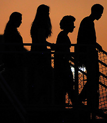 Fans leave the stadium after the stadium lost power during the first half of a college football game between HBU and SFA, Saturday, October 18, 2014, at Husky Stadium in Houston. (Photo: Eric Christian Smith/For the Chronicle)