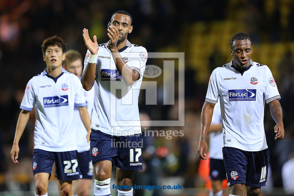 Lee Chung-Yong (left) Liam Trotter (centre) and Neil Danns (right) of Bolton Wanderers leave the pitch looking dejected following the Sky Bet Championship match defeat 2-1 to Norwich City at Carrow Road, Norwich<br /> Picture by Richard Calver/Focus Images Ltd +447792 981244<br /> 31/10/2014