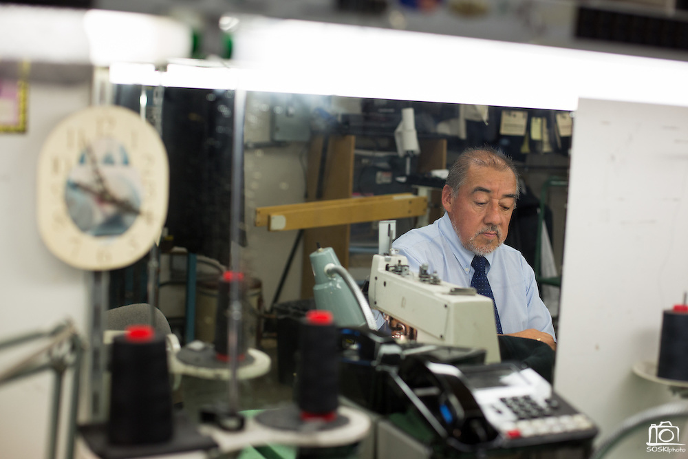 Tailor Luis Villafuerte adjusts the seam stitching on a jacket at Men's Wearhouse in Milpitas, Calif., on Sept. 19, 2012.  Photo by Stan Olszewski/SOSKIphoto.