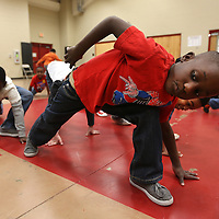 Adam Robison | BUY AT PHOTOS.DJOURNAL.COM<br /> Michael Bumphis, a Kindergartener at Parkway Elementary School, stretches during warm ups at the start of dance taught by Mary Frances Massey Tuesday morning at Parkway Elementary School in Tupelo.