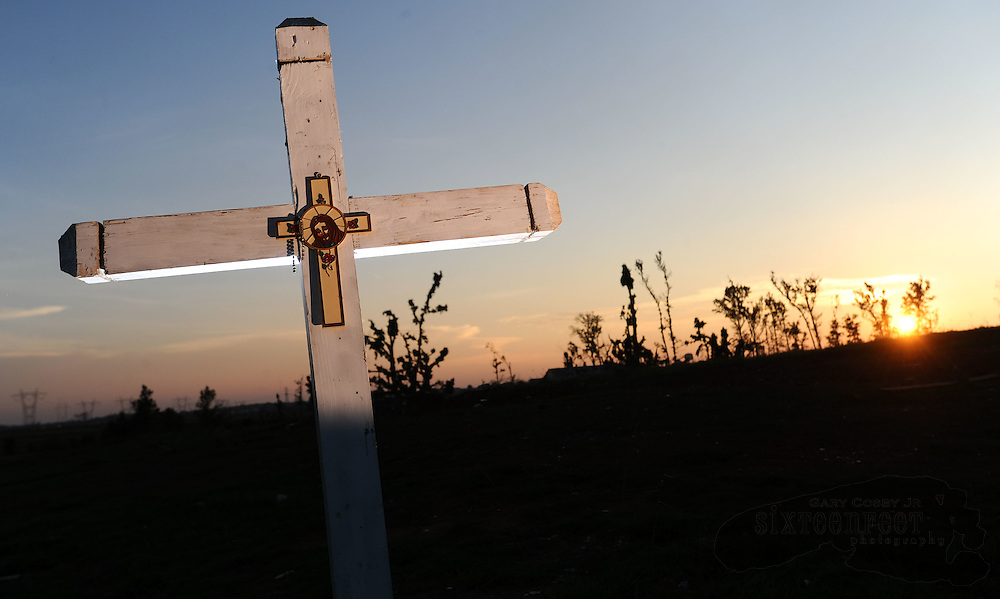 Daily Photo by Gary Cosby Jr.    ..A cross marks the spot where a woman died on Chipmunk Lane in eastern Limestone county when the April 27th tornado swept through.