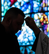 A young man receives ashes during an Ash Wednesday Mass March 6 at SS. Peter and Paul Church in Green Bay. Ash Wednesday marks the beginning of Lent. (Photo by Sam Lucero)