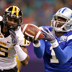 Dec 20, 2009; New Orleans, LA, USA; Middle Tennessee State Blue Raiders wide receiver Chris McClover (1) can't control the ball for a catch as Southern Miss Golden Eagles cornerback Marcal Robinson (15) defends during the second half of the 2009 New Orleans Bowl at the Louisiana Superdome. Middle Tennessee State defeated Southern Miss 42-32. Mandatory Credit: Derick E. Hingle-US PRESSWIRE