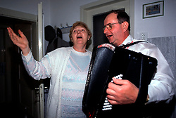 CZECH REPUBLIC MORAVIA BANOV APR98 - Tetka Zobakovich gestures while singing with Jiri Chovanec during his visit to her home during Easter 98.  During Easter, folklore dress, music and mutual visits are part of the customary traditional celebrations in Moravia.  jre/Photo by Jiri Rezac<br />