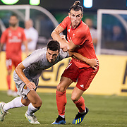 MEADOWLANDS, NEW JERSEY- August 7:  Gareth Bale #11 of Real Madrid challenged by Ivan Marcano #15 of AS Roma during the Real Madrid vs AS Roma International Champions Cup match at MetLife Stadium on August 7, 2018 in Meadowlands, New Jersey. (Photo by Tim Clayton/Corbis via Getty Images)