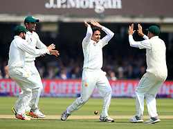 Pakistan's Mohammad Abbas (centre) celebrates taking the wicket of England's Alastair Cook during day three of the First NatWest Test Series match at Lord's, London.