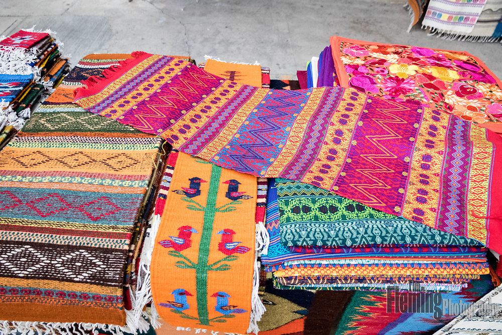 Handwoven textiles for sale on the sidewalk in Bucerias, Nayarit, Mexico.
