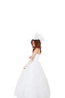 Young bride in wedding dress over white background