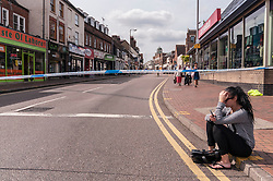 © Licensed to London News Pictures. 18/07/2015. Watord, Hertfordshire, UK. The city centre of Watford is brought to a standstill as roads are cordoned off amidst reports of the discovery of a suspect package in Market Street, which was detonated by the bomb disposal unit and the subseqent arrest of a person dressed in a burkha, today, the first day of the Muslim festival of Ramadan. Photo credit : Stephen Chung/LNP
