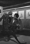 """Edward Delaney, the sculptor and artist who was born in Claremorris, Co. Mayo and studied in Dublin, Munich, Salzburg and Rome, arranges one of his pieces """"Anna Livia"""", a figure in bronze, at a one man exhibition at Little Theatre, Brown Thomas & Son, Grafton Street, Dublin..01.09.1960"""