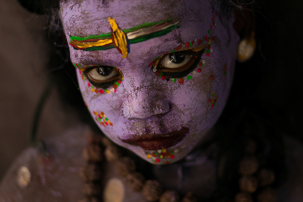 Kid on streets of Pushkar dressed as Lord Shiva. <br />