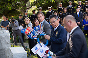 Milpitas City Council lay wreaths alongside war memorials during the Wreath Presentation during the City of Milpitas Memorial Day ceremony at Milpitas City Hall in Milpitas, California, on May 30, 2016. (Stan Olszewski/SOSKIphoto)