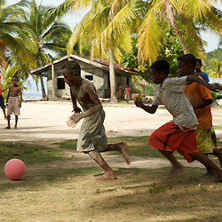 Papua kids playing football.