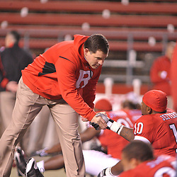 Nov 12, 2009; Piscataway, NJ, USA; Rutgers head coach Greg Schiano shakes hans with Rutgers tight end D.C. Jefferson (10) during warmups for NCAA Big East football action between Rutgers and South Florida at  Rutgers Stadium.