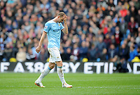 Football - 2013 / 2014 Premier League - Manchester City vs. West Ham United<br /> Manchester City's Edin Dzeko walks from the field having been substituted at the Etihad Stadium, Manchester