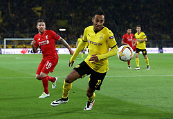 Pierre-Emerick Aubameyang of Borussia Dortmund tries to control a bouncing ball while Alberto Moreno of Liverpool watches on - Mandatory by-line: Robbie Stephenson/JMP - 07/04/2016 - FOOTBALL - Signal Iduna Park - Dortmund,  - Borussia Dortmund v Liverpool - UEFA Europa League Quarter Finals First Leg