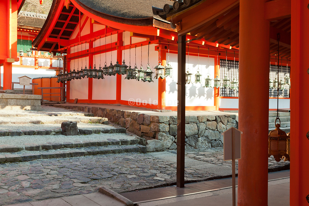 Kasuga shrine with lanterns hanging around building Nara Japan