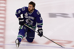 June 10, 2011; Vancouver, BC, CANADA; Vancouver Canucks left wing Tanner Glass (15) warms up before game five of the 2011 Stanley Cup Finals against the Boston Bruins at Rogers Arena. Vancouver defeated Boston 1-0. Mandatory Credit: Jason O. Watson / US PRESSWIRE