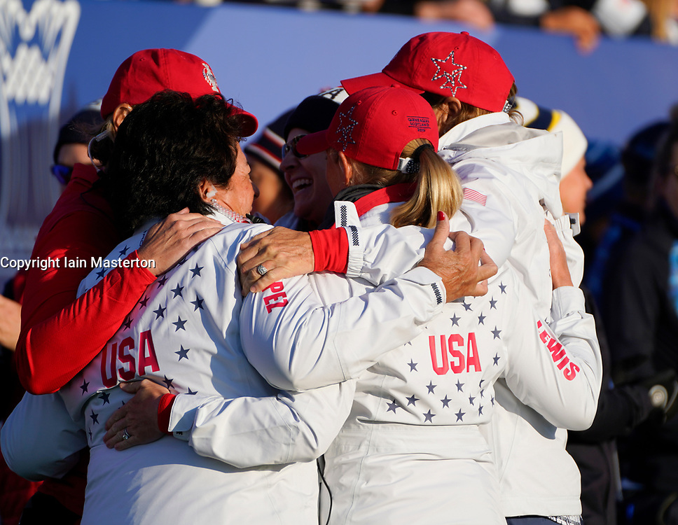 Solheim Cup 2019 at Centenary Course at Gleneagles in Scotland, UK. Team USA Captain and Vice Captains in group hug on 1st tee on final day.