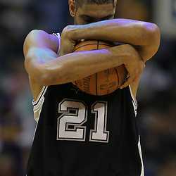 Jan 18, 2010; New Orleans, LA, USA; San Antonio Spurs center Tim Duncan (21) does his pre game ritual before tip off against the New Orleans Hornets at the New Orleans Arena. The Spurs defeated the Hornets 97-90. Mandatory Credit: Derick E. Hingle-US PRESSWIRE