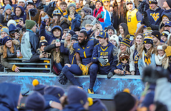 Nov 10, 2018; Morgantown, WV, USA; West Virginia Mountaineers fans celebrate with players after beating the TCU Horned Frogs at Mountaineer Field at Milan Puskar Stadium. Mandatory Credit: Ben Queen-USA TODAY Sports