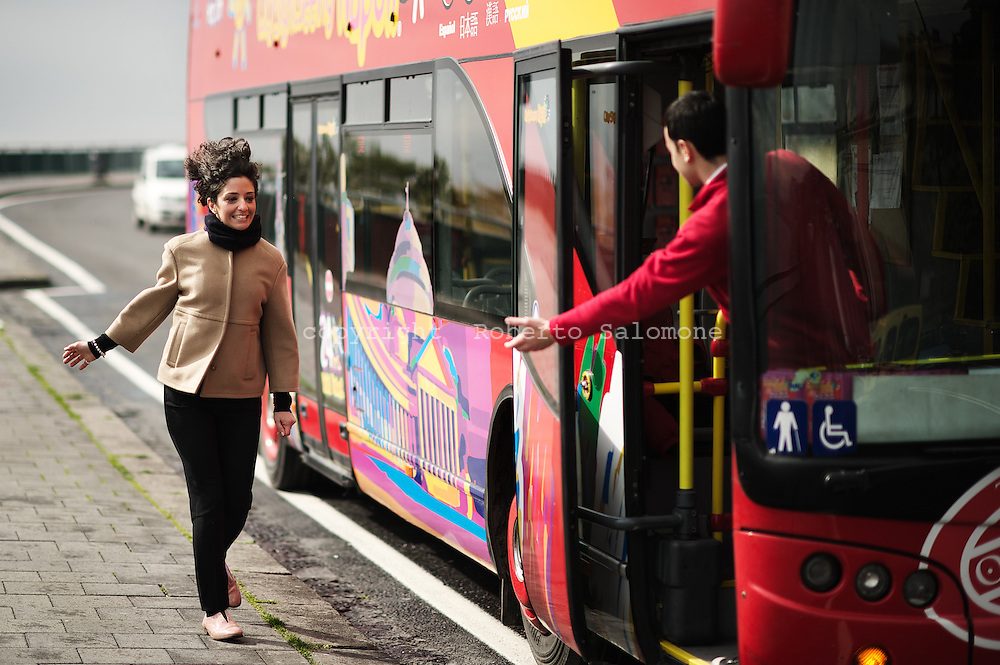 Napoli, Italia - 8 marzo 2012. Roberta Calvanese, 30 anni, imprenditrice napoletana, ritratta a bordo di uno dei suoi bus turistici (sullo sfondo Napoli). Da sei anni gestisce tra Napoli e la costiera sorrentina un'azienda di bus turistici di City Sightseeing..Ph. Roberto Salomone Ag. Controluce.ITALY - Roberta Calvanese, 30, CEO for Naples and Amlfi coast of City Sightseeing company.