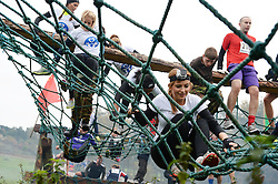 **EXCLUSIVE** ©  London News Pictures. 02/11/2013. Sam Cooke (bottom right), girlfriend of Manchester United footballer, Chris Smalling tackles a rope bridge with other WAGs. Wives and girlfriends of Premiership football players do part of the famous Tough Guy event in Wolverhampton, UK. Mandatory photo credit : Mike King/LNP