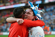 Coventry City defender Chris Stokes (3) celebrates as Coventry City win the  EFL Trophy Final match between Coventry City and Oxford United at Wembley Stadium, London, England on 2 April 2017. Photo by Simon Davies.