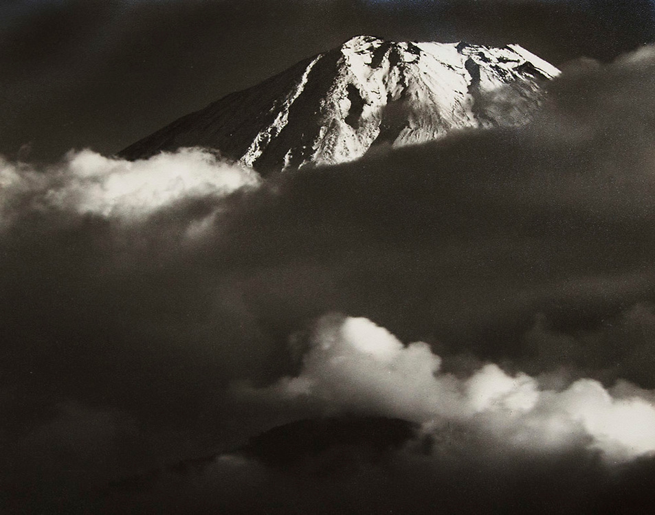 Okada Koyo<br /> Mt. Fuji in clouds (official title unknown)<br /> Date: 1940s - mid 1950s<br /> <br /> Description: Vintage or near vintage, double weight, gelatin silver print, with textured semi-matte surface.<br /> <br /> Condition: deep rich tones with a minor amount of silvering at the edges, with some light warping in the upper left corner.<br /> <br /> Size: 10 1/4 in. x 8 1/4 in. (260 mm x 210 mm).<br /> <br /> Price: &yen;100,000 JPY<br /> <br /> <br /> <br /> <br /> <br /> <br /> <br /> <br /> <br /> <br /> <br /> <br /> <br /> <br /> <br /> <br /> <br /> <br /> <br /> <br /> <br /> <br /> <br /> <br /> <br /> <br /> <br /> <br /> <br /> <br /> <br /> <br /> <br /> <br /> <br /> <br /> <br /> <br /> <br /> <br /> <br /> <br /> <br /> <br /> <br /> <br /> <br /> <br /> <br /> <br /> <br /> <br /> <br /> <br /> <br /> <br /> <br /> <br /> <br /> <br /> <br /> <br /> <br /> <br /> <br /> <br /> <br /> <br /> <br /> <br /> <br /> <br /> <br /> <br /> <br /> <br /> <br /> <br /> <br /> <br /> <br /> <br /> .