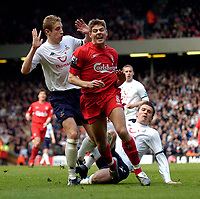 Photo. Jed Wee.<br /> Liverpool v Tottenham Hotspurs, Barclays Premiership, 16/04/2005.<br /> Liverpool's Steven Gerrard (C) is felled by a tackle from Tottenham's Michael Carrick for his team's penalty.