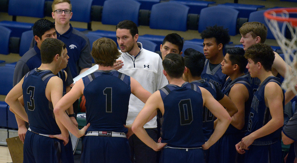 gbs122816jSPORTS --  Piedra Vista coach Devon Manning talks to his players during a time out in the Holiday Hoops Classic at Rio Rancho High School on Wednesday, December 28, 2016. (Greg Sorber/Albuquerque Journal)