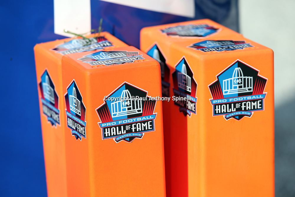 Four end zone pylons bearing the Pro Football Hall of Fame logo stand next to the goal post before the Green Bay Packers 2016 NFL Pro Football Hall of Fame preseason football game against the Indianapolis Colts on Sunday, Aug. 7, 2016 in Canton, Ohio. The game was canceled for player safety reasons due to the condition of the paint on the turf field. (©Paul Anthony Spinelli)