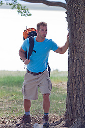 good looking man backpacking in New Mexico