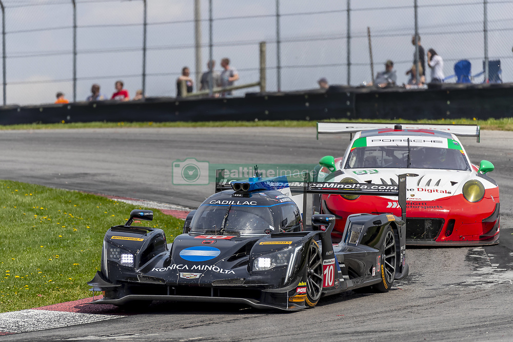 May 6, 2018 - Lexington, Ohio, United States of America - The Konica Minolta Business Solutions USA Cadillac DPI car races through the keyhole turn during the the Acura Sports Car Challenge at Mid Ohio Sports Car Course in Lexington, Ohio. (Credit Image: © Walter G Arce Sr Asp Inc/ASP via ZUMA Wire)