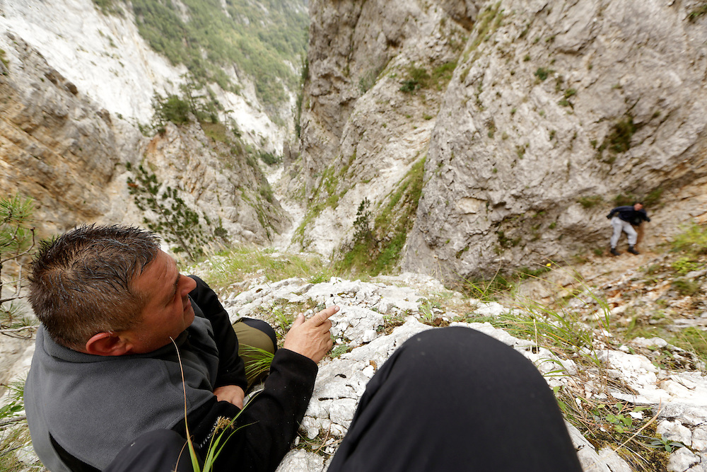 Senad Djelmo Kulja, and Boris, the stranded hiker from the city of Mostar at Čvrsnica mountain, below Veliki Kuk cliff face, Bosnia and Herzegovina.  The uninjured hiker was found standing on a very small ledge in a narrow couloir, unable to move in any direction due to its perilous position.