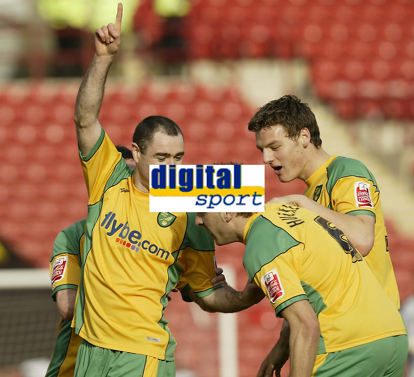 Photo: Aidan Ellis.<br /> Barnsley v Norwich City. Coca Cola Championship. 03/03/2007.<br /> Norwich's Andy Hughes (L) celebrates with Darren Huckerby, and Chris Martin after the first goal