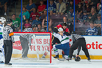 PENTICTON, CANADA - SEPTEMBER 10: Yan-Pavel Laplante #74 of Vancouver Canucks drops the gloves with Hunter Smith #71 of Calgary Flames on September 10, 2017 at the South Okanagan Event Centre in Penticton, British Columbia, Canada.  (Photo by Marissa Baecker/Shoot the Breeze)  *** Local Caption ***