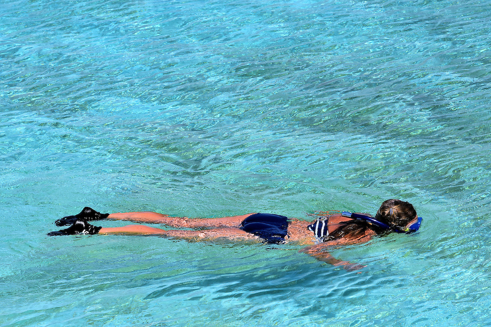 Woman Snorkeling in Lagoon at Half Moon Cay, Bahamas <br />