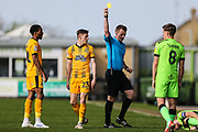 Cambridge United's Tom Knowles(23) is shown a yellow card, booked during the EFL Sky Bet League 2 match between Forest Green Rovers and Cambridge United at the New Lawn, Forest Green, United Kingdom on 22 April 2019.