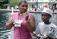 A youngster wears his Krispy Kreme hat as he  gets ready to sample the fare from Fleming's Prime Steakhouse during the 21st annual The Taste in the Lincoln Park Commons area at the Fraze Pavilion, Thursday, September 3, 2009.