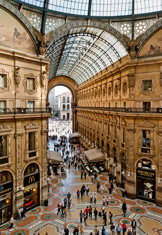 Elevated view of Galleria Vittorio Emanuele II in Milan on May 2, 2012. Built in 1875 this gallery is one of the most popular landmarks in Milan. The picture, taken from a hardly accessible balcony, offers a unique view of the gallery from above