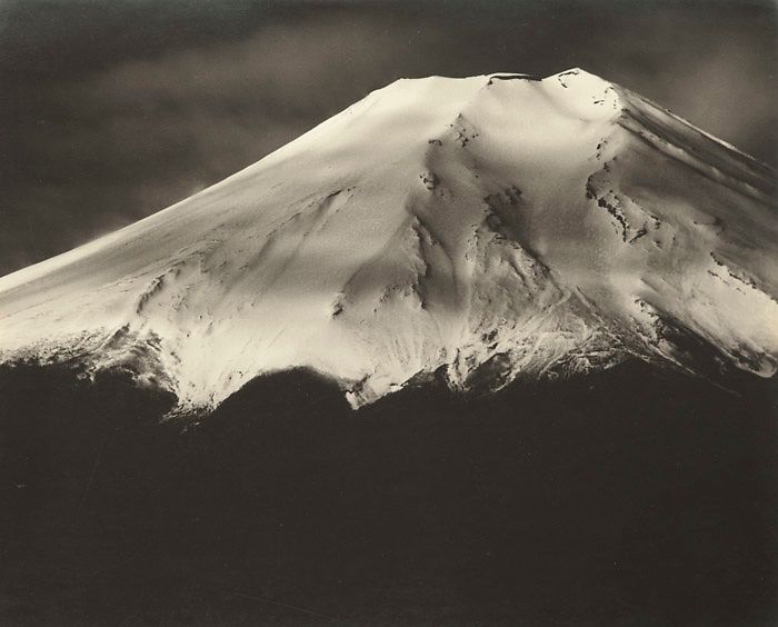 Okada Koyo<br /> Fresh Snow (from Oshino)<br /> Date: 1940s<br /> <br /> Description: Detailed graphic study of the cone of Mount Fuji, taken in the 1940s. This same photo was published in &ldquo;Mt. Fuji&rdquo;, by Okada Koyo, Hobundo Publishing, Tokyo, 1964, plate number 92. In this book, the caption reads:<br /> <br /> &ldquo;Fresh Snow (from Oshino). On a clear morning, Fuji always seems to be in excellent spirits. Today, she is a happy woman with powdered face and laughing lips. In this photo, I used the shadow of the clouds to emphasize the whiteness of the peak&rdquo;.<br /> <br /> Vintage or near vintage, double weight, gelatin silver print, with smooth semi-matte surface, unsigned.<br /> <br /> Condition: Very good with deep rich tones, this is a stunning print. The print comes matted in an archival mat board.<br /> <br /> Size: 10 1/4 in. x 8 1/4 in. (260 mm x 210 mm).<br /> <br /> Price: &yen;175,000 JPY<br /> <br /> <br /> <br /> <br /> <br /> <br /> <br /> <br /> <br /> <br /> <br /> <br /> <br /> <br /> <br /> <br /> <br /> <br /> <br /> <br /> <br /> <br /> <br /> <br /> <br /> <br /> <br /> <br /> <br /> <br /> <br /> <br /> <br /> <br /> <br /> <br /> <br /> <br /> <br /> <br /> <br /> <br /> <br /> <br /> <br /> <br /> <br /> <br /> <br /> <br /> <br /> <br /> <br /> <br /> <br /> <br /> <br /> <br /> <br /> <br /> <br /> <br /> <br /> <br /> <br /> <br /> <br /> <br /> <br /> <br /> <br /> <br /> <br /> <br /> <br /> <br /> <br /> <br /> <br /> <br /> <br /> <br /> .