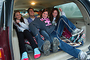 PRICE CHAMBERS / NEWS&amp;GUIDE<br /> Aubrey Durbin, Bryce Beard and Andee and Kenzie Calderwood get comfortable in back of a SUV on Saturday as they await the double feature at The Spud. The drive in movie theater broadcasts the audio from the film to your car's radio.