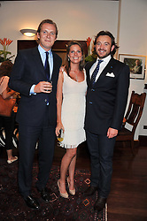 Left to right, GEORGE & CATHERINE CADBURY and ALEXANDER MAVROS at a party to celebrate the launch of the new Mauritius Collection of jewellery by Forbes Mavros held at Patrick Mavros, 104-106 Fulham Road, London SW3 on 5th July 2011.