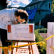 Resident of a collapsed home in Los Gatos looks in donations box for cash to fix his home not covered by earthquake insurance after hit by the 6.9 magnitude 1989 Loma Prieta earthquake.