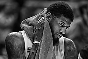 Paul George of the Indiana Pacers sits on the bench during a timeout at Bankers Life Fieldhouse in Indianapolis, Indiana.