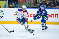 PENTICTON, CANADA - SEPTEMBER 16: Curtis Valk #43 of Vancouver Canucks stick checks Caleb Jones #81 of Edmonton Oilers ask he skates with the puck on September 16, 2016 at the South Okanagan Event Centre in Penticton, British Columbia, Canada.  (Photo by Marissa Baecker/Shoot the Breeze)  *** Local Caption *** Curtis Valk; Caleb Jones;