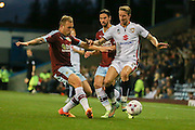 Burnley midfielder Scott Arfield tackles Milton Keynes Dons midfielder Carl Baker during the Sky Bet Championship match between Burnley and Milton Keynes Dons at Turf Moor, Burnley, England on 15 September 2015. Photo by Simon Davies.